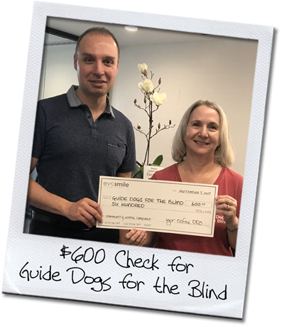 EvoSmile's Dr. Igor Ochev presents a check to Guide Dogs for the Blind